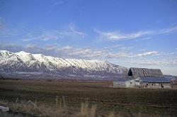Snowy Mountains with old barn